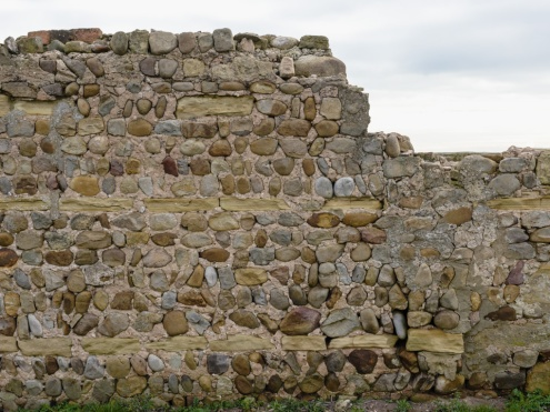 Composite wall, Cana. Built from field stone and reused masonary, a common local building method.